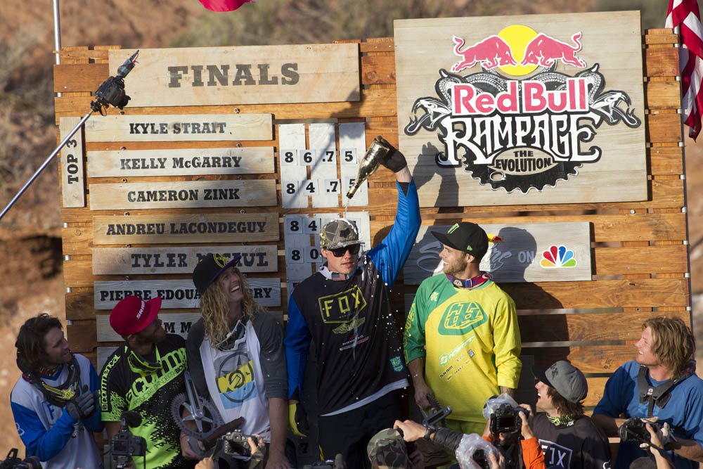 Riders celebrate on the podium at Red Bull Rampage in Virgin, UT, USA on 13 October, 2013. From left: Cam McCaul, Pierre Edouard Ferry, Kelly McGarry (2nd), Kyle Strait (1st), Cam Zink (3rd), Tyler McCaul and Garett Buehler. // John Gibson/Red Bull Content Pool // P-20131014-00040 // Usage for editorial use only // Please go to www.redbullcontentpool.com for further information. //