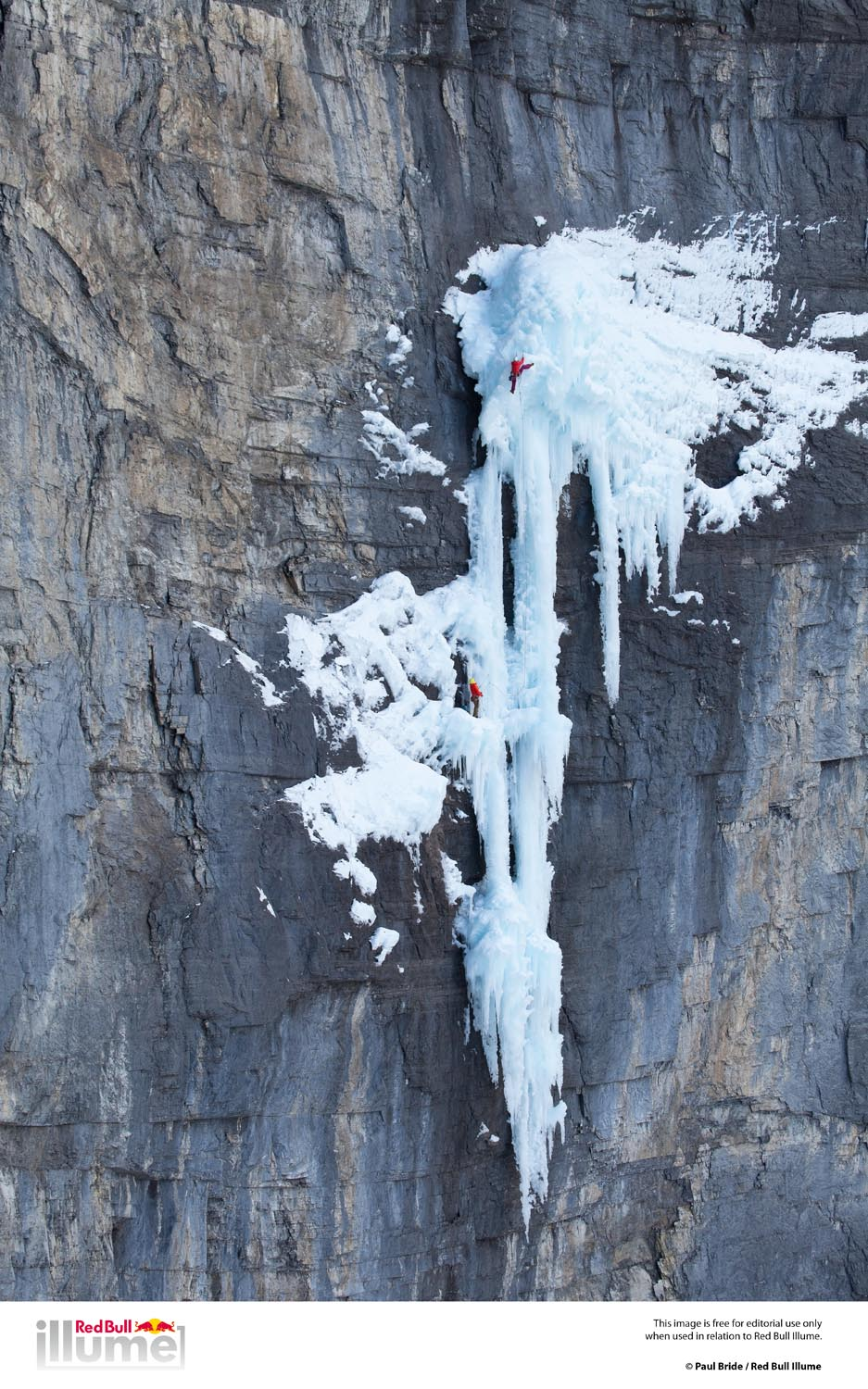 Climber Jen Olson belayed by Kyle Vassilopoulous on the hanging ice dagger known as The Real Big DripM7+ WI6+ Ghost River Canadian Rockies Alberta